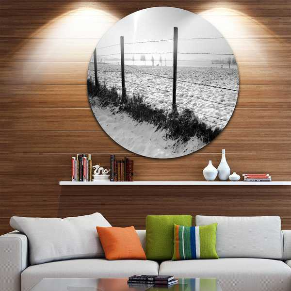 Designart 'Landscape in Snow with Fence' Beach Disc Metal Wall Art